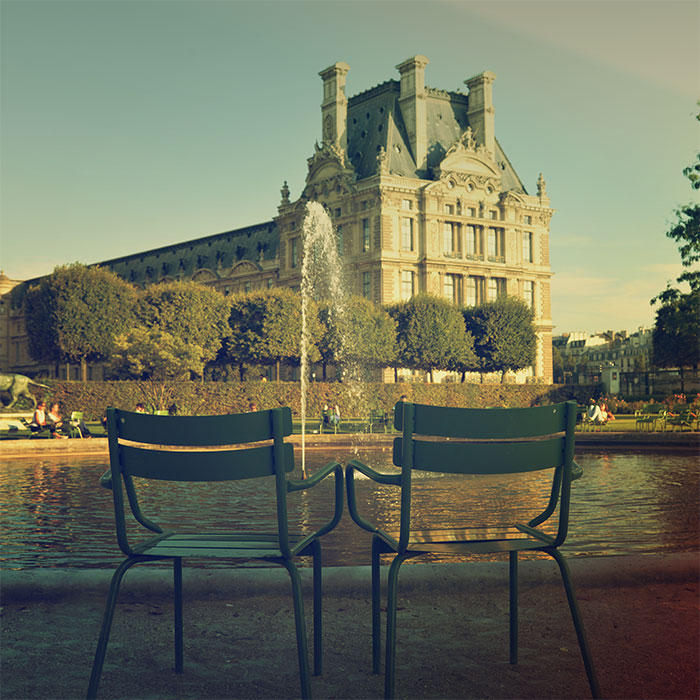 green chairs at jardin tuileries